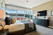 This carpeted bedroom overlooks AT&T Park.