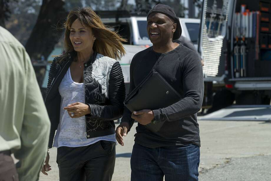 """Actress Nicole Ari Parker (left) and director Kim Bass work on the set on Treasure Island for Bass' new movie, """"HeadShop."""" Photo: Santiago Mejia, The Chronicle"""