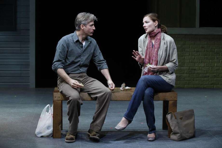 """In this theater publicity image released by the Vineyard Theatre, Linus Roache, left, and Heather Burns are shown in a scene from """"Middletown,"""" playing at the Vineyard Theatre in New York.  (AP Photo/Vineyard Theatre, Carol Rosegg) Photo: AP / Vineyard Theatre"""