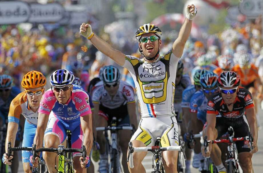 Mark Cavendish of Britain crosses the finish line to win the 11th stage of the Tour de France cycling race over 184.5 kilometers (114.6 miles) with start in Sisteron and finish in Bourg-les-Valences, France, Thursday, ahead of Tyler Farrar of the U.S., far left, Alessandro Petacchi of Italy, second left, and Jose Joaquin Rojas of Spain, far right. (AP Photo/Laurent Rebours) Photo: AP / AP