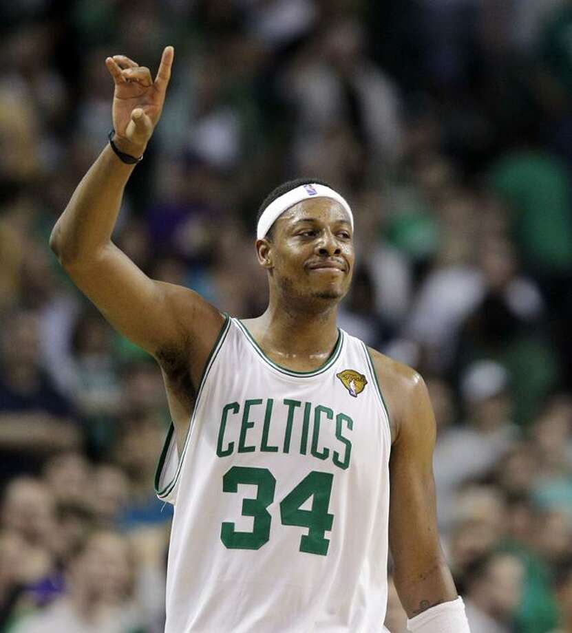 This June 13, 2010, file photo shows Boston Celtics forward Paul Pierce celebrating during Game 5 of the NBA basketball finals against the Los Angeles Lakers,  in Boston. A Boston Celtics official says the team has agreed to terms with Paul Pierce on a new contract. (AP Photo/Michael Dwyer, File) Photo: AP / AP