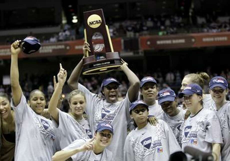 UConn players celebrate following their women's college basketball championship Tuesday. (Associated Press) Photo: ASSOCIATED PRESS / AP2010