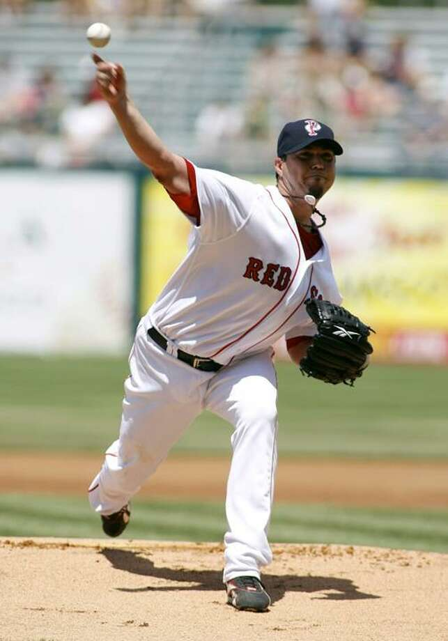 Boston Red Sox's Josh Beckett pitches for the Pawtucket Red Sox in a baseball game against the Syracuse Chiefs in a Triple-A rehab stint Sunday in Pawtucket, R.I. (AP Photo/Joe Giblin) Photo: AP / FR88264 AP