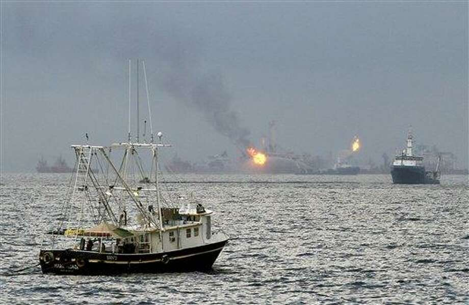 A commercial fishing vessel assisting in the containment of oil leaking from the Deepwater Horizon oil wellhead sails towards the site of the leak on the Gulf of Mexico near the coast of Louisiana Thursday, July 15, 2010. (AP Photo/Patrick Semansky) Photo: AP / FR158704 AP