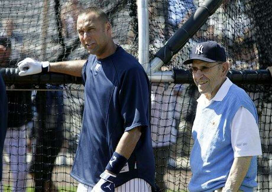 New York Yankees Hall of Fame catcher Yogi Berra, right, talks with Yankees shortstop Derek Jeter, left, during a baseball spring training workout Wednesday, Feb. 23, 2011, at Steinbrenner Field in Tampa, Fla. (AP Photo/Charlie Neibergall) Photo: AP / AP