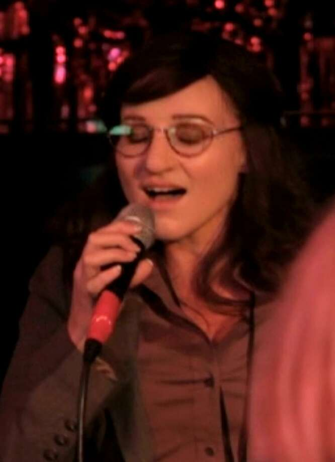 """In this publicity image released by <a href=""""http://FunnyOrDie.com"""">FunnyOrDie.com</a>, singer Jewel, left, wears a disguise as she performs at a Los Angeles karaoke bar in a scene from a comedy video posted on <a href=""""http://FunnyOrDie.com"""">FunnyOrDie.com</a>. (AP Photo/FunnyOrDie.com) Photo: AP / FunnyOrDie.com"""