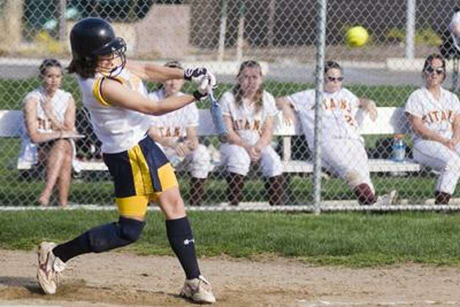 Mercy's Victoria Vickerman makes contact with a pitch Thursday against Sheehan at Mercy High School. (Max Steinmetz / Special to the Press)