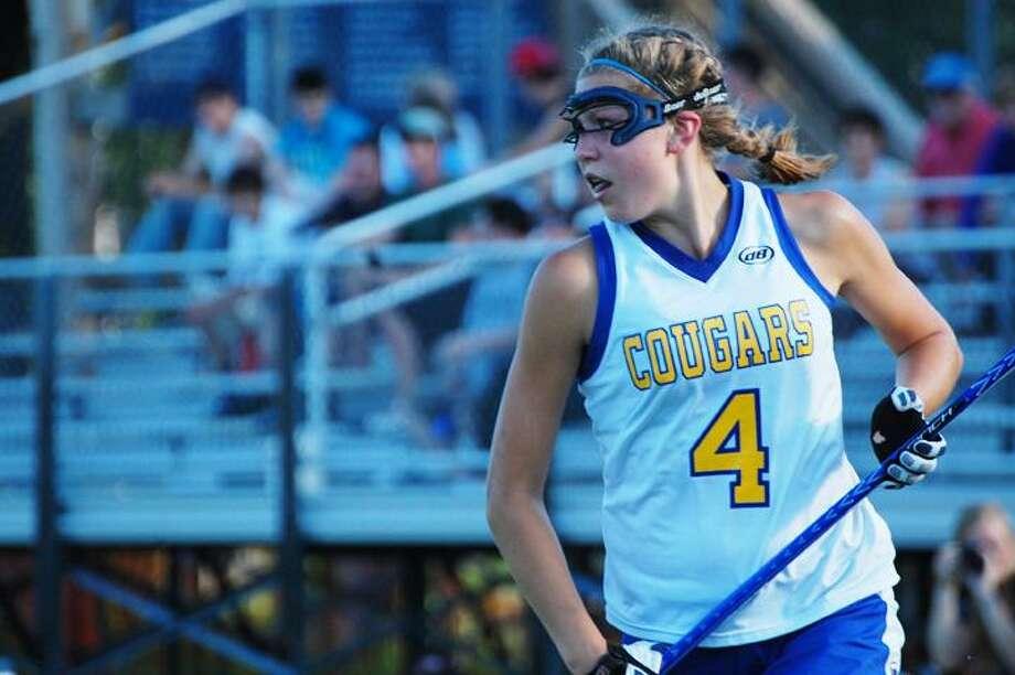 Haddam-Killingworth graduate Emily Anderson looks upfield in a postseason game during her senior year.
