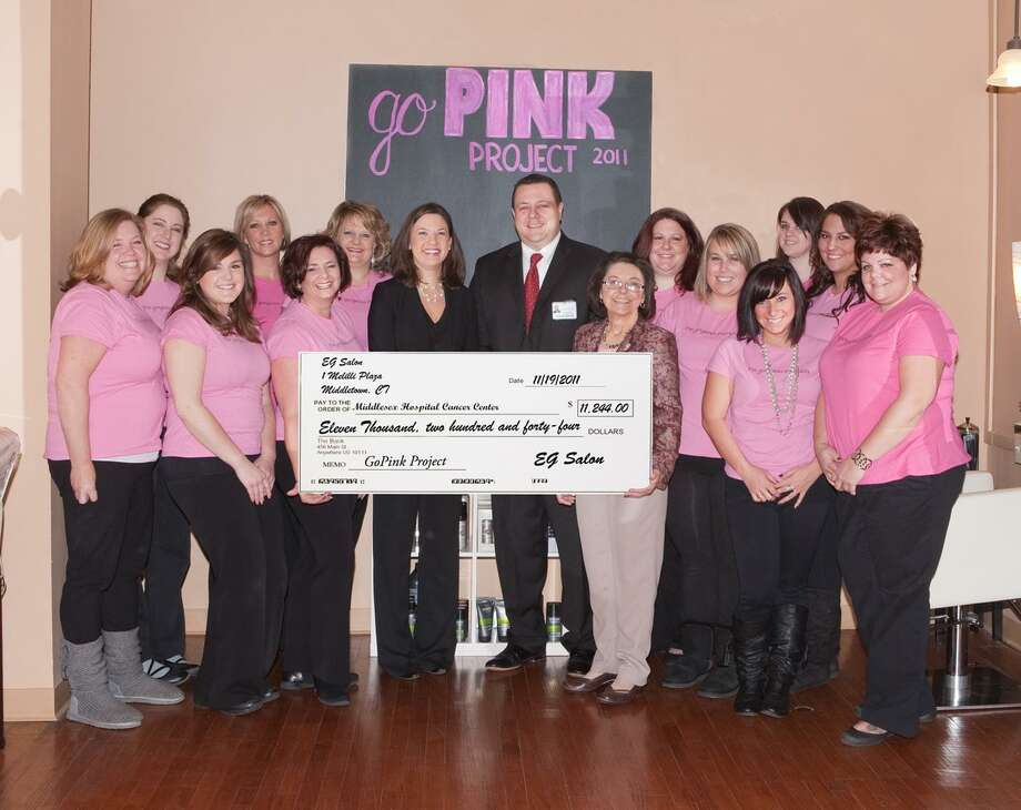 The staff of EG Salon in Middletown recently presented a check for $11,244 to the Middlesex Hospital Comprehensive Breast Center as part of the annual Go Pink! fundraiser. Holding the check, from left to right, are EG Salon owners Ellie Gagnon and Georgi Marino; Middlesex Hospital Comprehensive Breast Center Coordinator, Meghan Burgess; Director, Cancer Center and Oncology Services, Gary Havican; and Breast Cancer Nurse Navigator, Pat O'Brien. (Photo by Marie Curtis) / ©John Giammatteo 2011