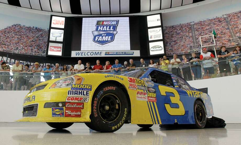 The car Dale Earnhardt Jr. drove to victory at Daytona is shown during a news conference at the NASCAR Hall of Fame in Charlotte, N.C., Wednesday. The car will be in exhibit at the museum until September. (AP Photo/Chuck Burton) Photo: AP / AP