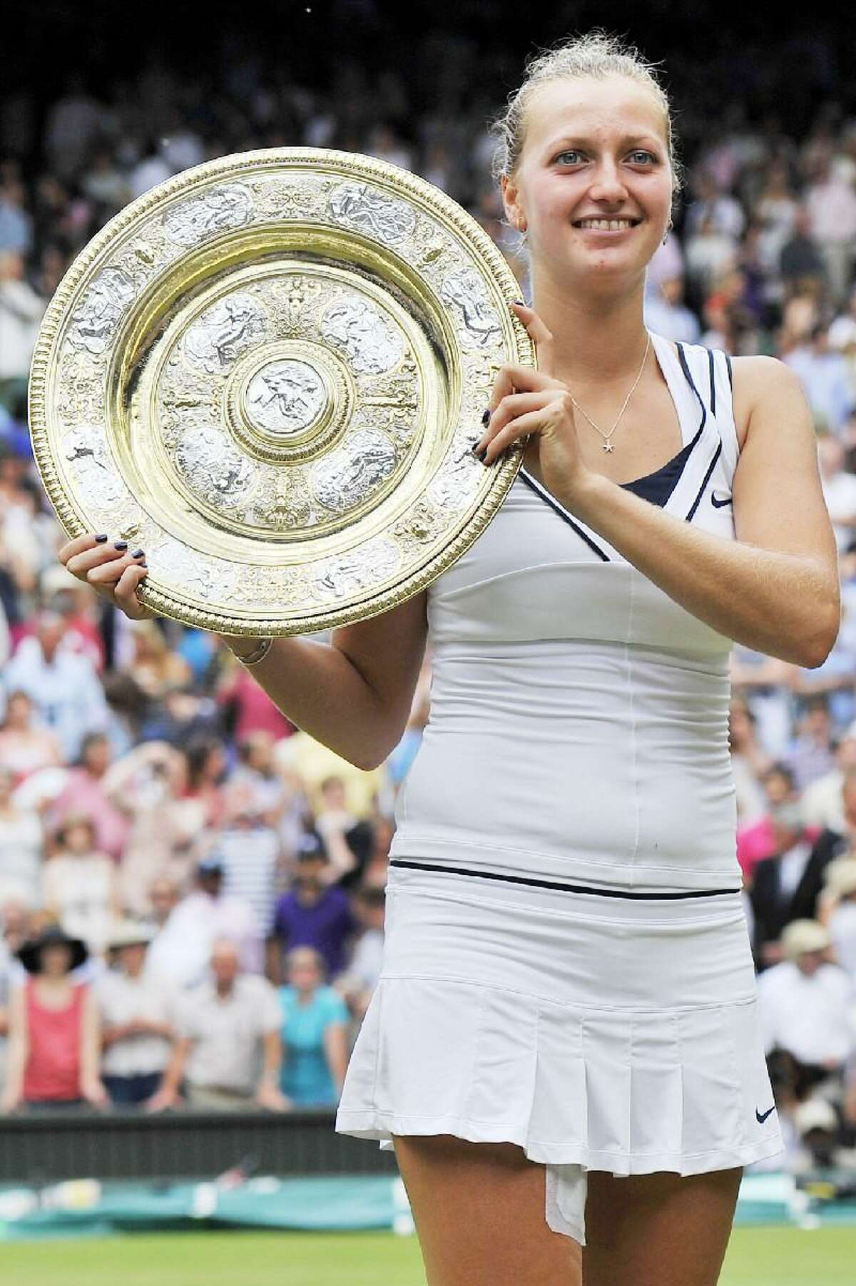 ASSOCIATED PRESS Petra Kvitova stuns Maria Sharapova by beating her 6-3, 6-4 in the Wimbledon women's final Saturday at The All England Lawn Tennis and Croquet Club.