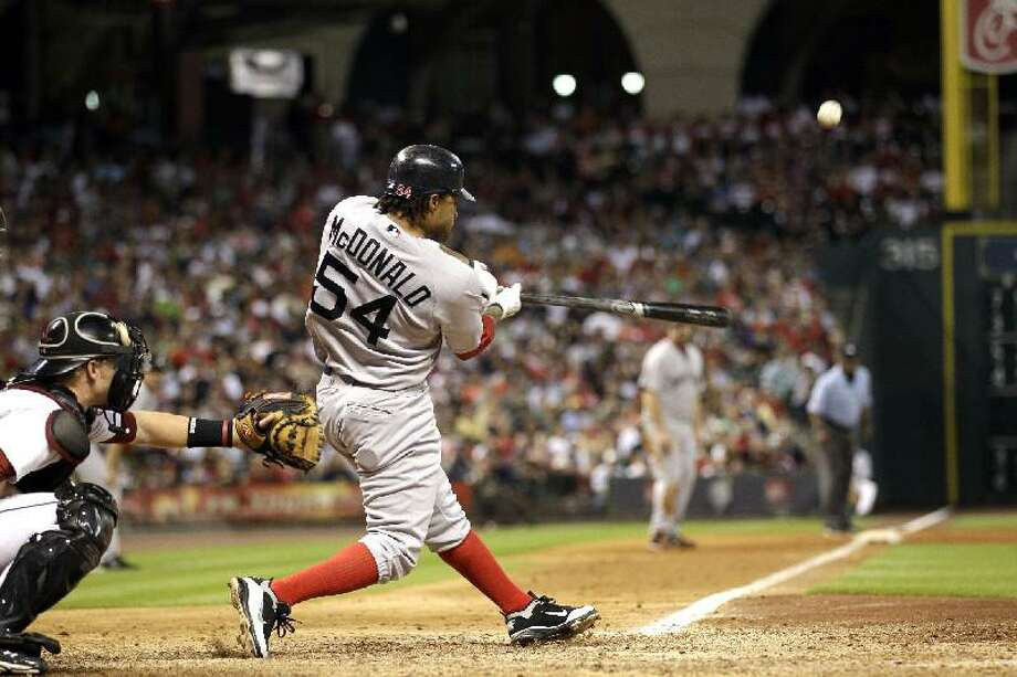 ASSOCIATED PRESS Boston's Darnell McDonald (54) hits a three-run home run as Houston Astros catcher J.R. Towles reaches for the pitch during the eighth inning of an interleaguel game Saturday in Houston. The Red Sox won 10-4.