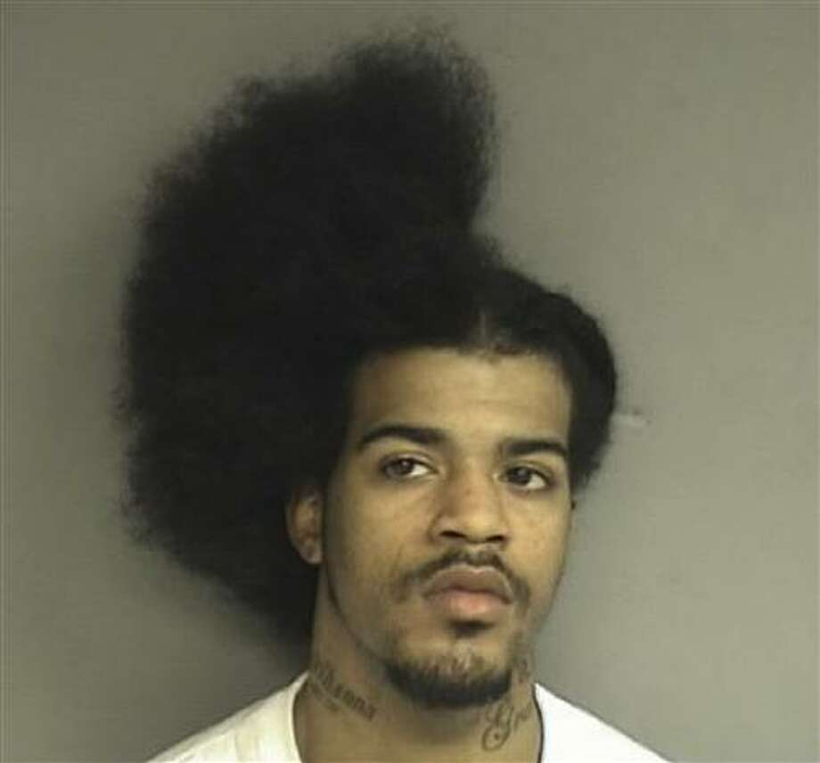 This Tuesday, March 8, 2011 booking photo released by the Stamford, Conn., Police shows David C. Davis, 21, of New Haven, Conn., who was arrested Tuesday and charged with slashing another man in the back while he was in the middle of a haircut.  (AP Photo/Stamford Police Department) Photo: ASSOCIATED PRESS / AP2011