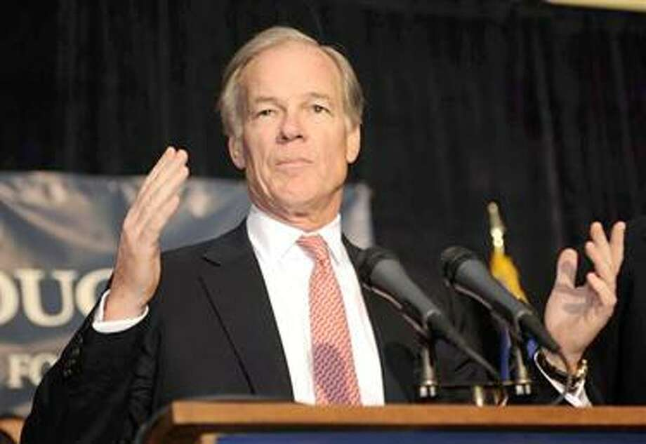 Connecticut Republican Gubernatorial candidate Tom Foley explains to supporters in Greenwich, Conn., Wednesdahy Nov. 3, 2010 that final results in the Connecticut race will not be finalized until  later in the morning Wednesday at the earliest. (AP Photo/Fred Beckham) Photo: AP / FR153656 AP