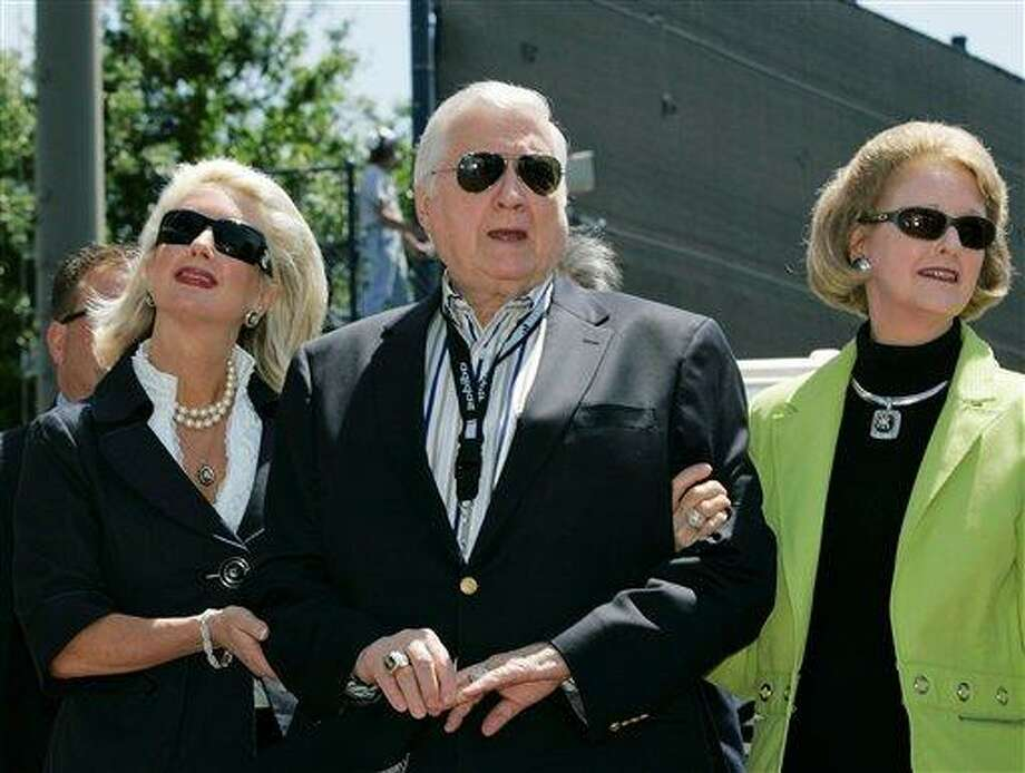 In this March 27, 2008 file photo, New York Yankees senior vice president for new stadium public affairs Jennifer Steinbrenner Swindal, left, holds onto her father and Yankees principal owner George Steinbrenner, center, along with his wife, Joan, during a pregame ceremony renaming Legends Field to George  M. Steinbrenner Field at spring training baseball, in Tampa, Fla.  The Yankees said Steinbrenner died Tuesday morning, July 13, 2010.(AP) Photo: AP / AP2008