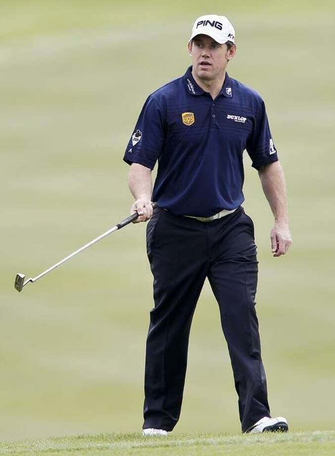 Lee Westwood of Britain walks on the 1st hole green during the Pro-Am event of the Shanghai HSBC Champions golf tournament, which begins Thursday, at the Sheshan International Golf Club in Shanghai, China, Wednesday. (AP Photo/Andy Wong) Photo: AP / AP