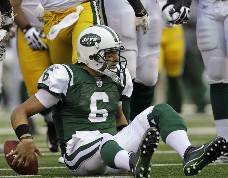New York Jets quarterback Mark Sanchez (6) sits on the turf after being sacked by Green Bay Packers linebacker Brandon Chillar (54) during the first quarter of an NFL football game at New Meadowlands Stadium on Sunday in East Rutherford, N.J. (AP Photo/Kathy Willens) Photo: AP / AP