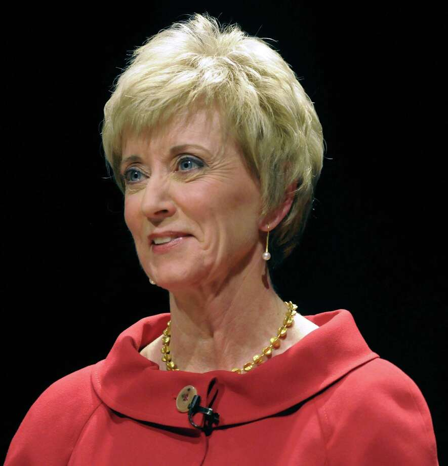 FILE - In this March 2, 2010 file pool photo, former World Wrestling Entertainment CEO Linda McMahon attends a debate with money manager Peter Schiff and former Congressmen Rob Simmons at the Lincoln Theater on the University of Hartford campus in West Hartford, Conn. The widow of a World Wrestling Entertainment performer who died in a 1999 stunt says she's suing the Connecticut-based company and its leaders, including Republican U.S. Senate candidate Linda McMahon. Martha Hart, widow of Owen Hart, plans to file her lawsuit Tuesday, June 22, 2010, in U.S. District Court in Hartford. (AP Photo/John Woike, Pool, File) Photo: ASSOCIATED PRESS / Pool The Hartford Courant
