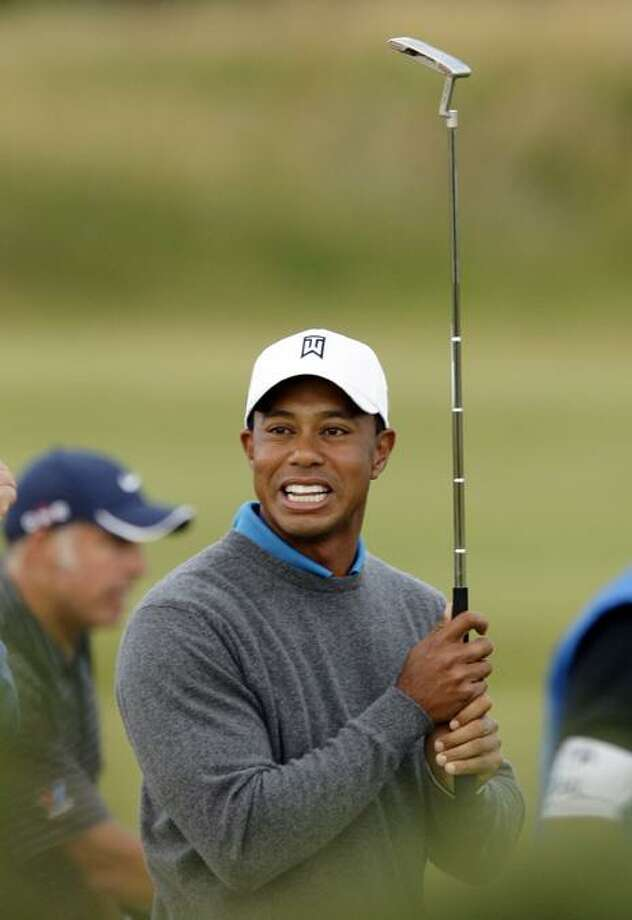 Tiger Woods reacts to a putt on the 4th hole during a practice round on the Old Course at St. Andrews, Scotland, prior to the British Open Golf Championship, Tuesday. (AP Photo/Jon Super) Photo: AP / AP