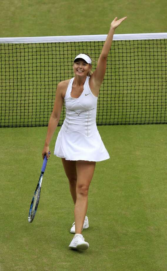 ASSOCIATED PRESS Russia's Maria Sharapova celebrates defeating Germany's Sabine Lisicki in their semifinal match at the All England Lawn Tennis Championships at Wimbledon Thursday. Sharapova faces Petra Kvitova in the final.