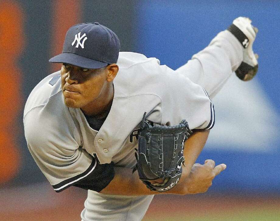 ASSOCIATED PRESS New York Yankees starter Ivan Nova throws a pitch during the first inning of an interleague game against the New York Mets at Citi Field in New York Friday. The Yankees won 5-1.