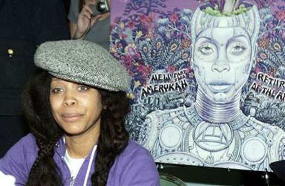 "(AP) Singer Erykah Badu signs autographs for her new album ""New Amerykah, Pt. 2: Return of the Ankh"" in Dallas on Saturday. Photo: ASSOCIATED PRESS / AP2010"