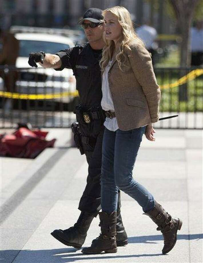 Actress Daryl Hannah is arrested by U.S. Park Police in front of the White House in Washington, Tuesday, Aug. 30, 2011, during a protest against the Keystone oil pipeline.  (AP Photo/Evan Vucci) Photo: AP / AP