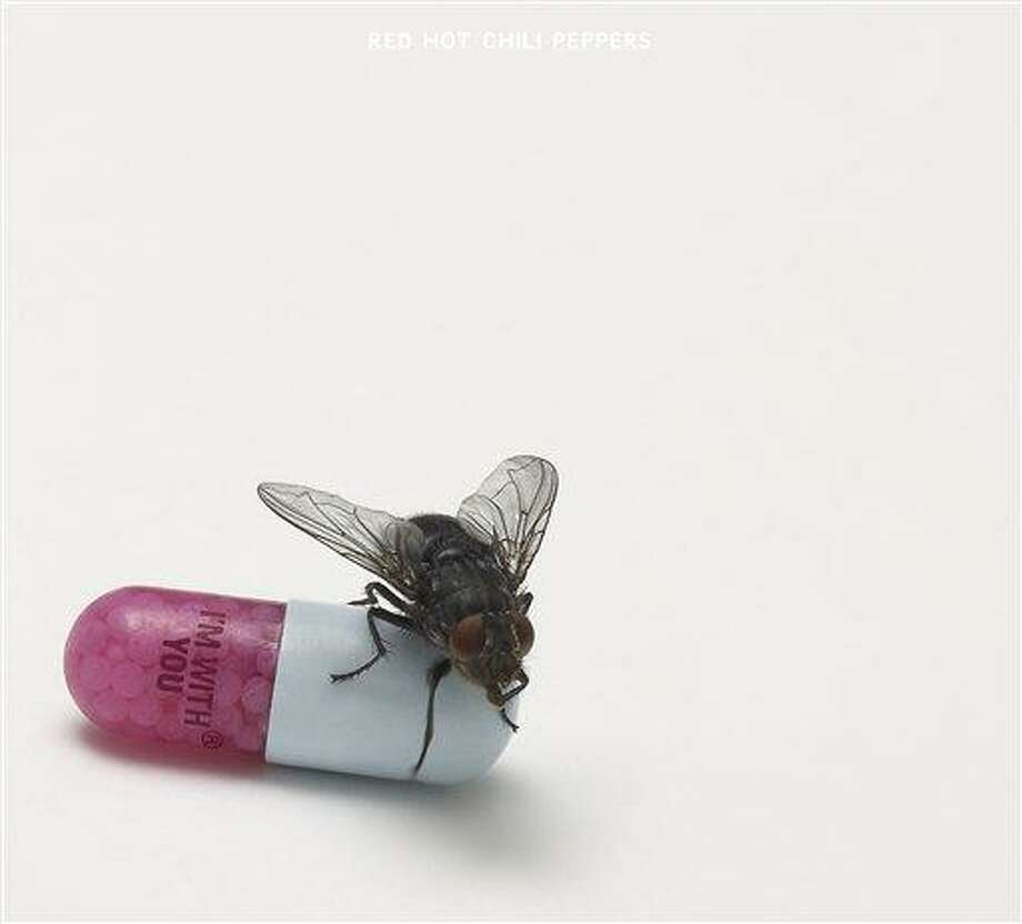 """In this CD cover image released by Warner Bros. Records, the latest by Red Hot Chili Peppers, """"I'm With You,"""" is shown. (AP Photo/Warner Bros. Records) Photo: AP / Warner Bros. Records"""