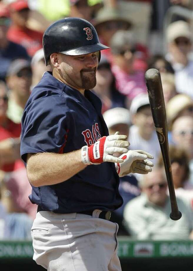 Boston Red Sox' Kevin Youkilis reacts during a spring training baseball game against the St. Louis Cardinals Tuesday, March 8, 2011 in Jupiter, Fla. (AP Photo/Carlos Osorio)