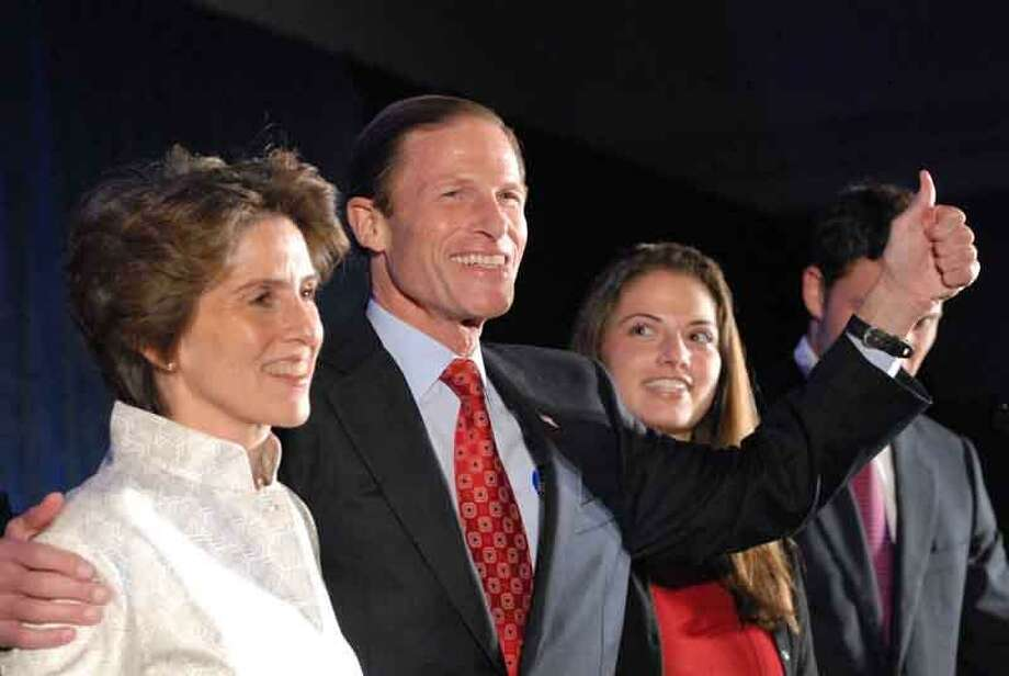 Democrat Richard Blumenthal makes his victory speech at the Hartford Hilton hotel in Hartford Tuesday night with family at his side as he wins the U.S. Senate race  over Republican Linda McMahon. Peter Hvizdak/New Haven Register
