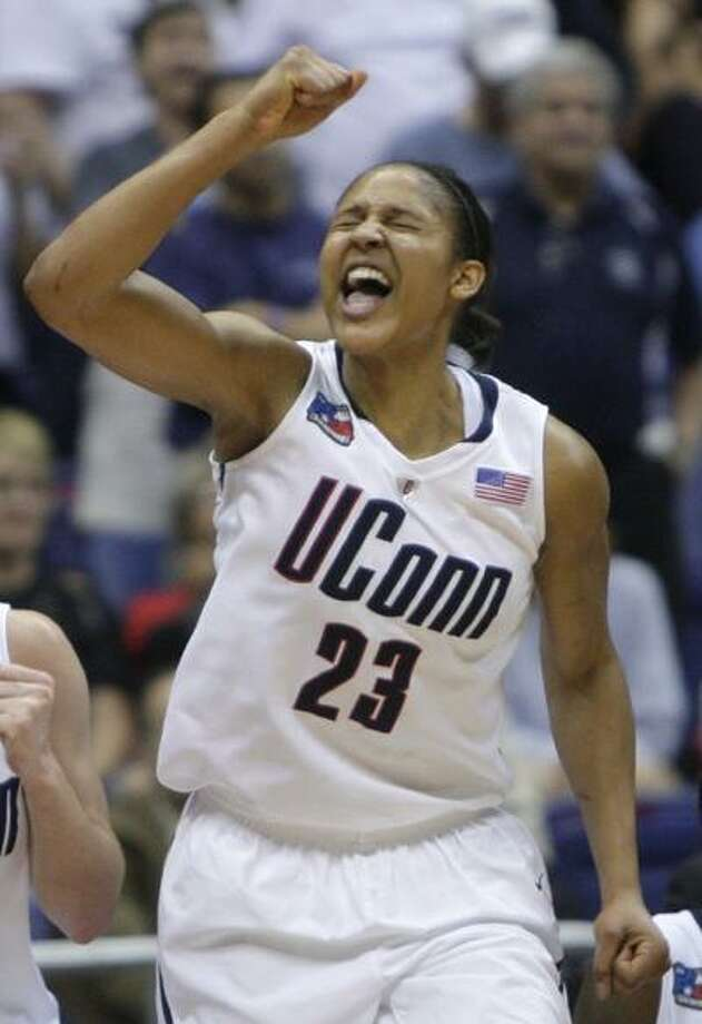 Connecticut's Maya Moore celebrates after Connecticut defeated Baylor 70-50 in a semifinal in the Final Four of the NCAA women's college basketball tournament Sunday. Connecticut faces Stanford on Tuesday night for the title. (Associated Press) Photo: ASSOCIATED PRESS / AP2010