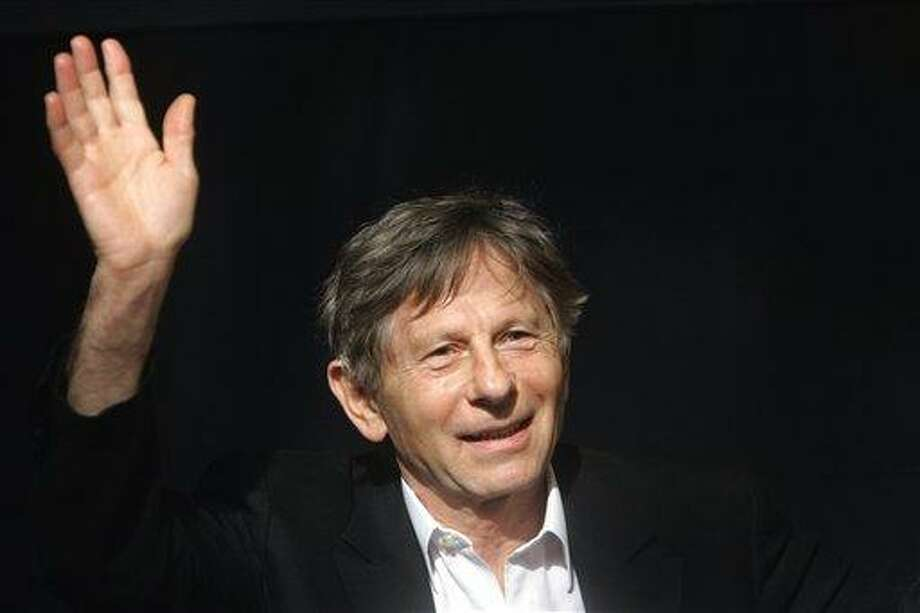 French-born film director Roman Polanski waves during a media presentation in Berlin. (AP) Photo: ASSOCIATED PRESS / AP