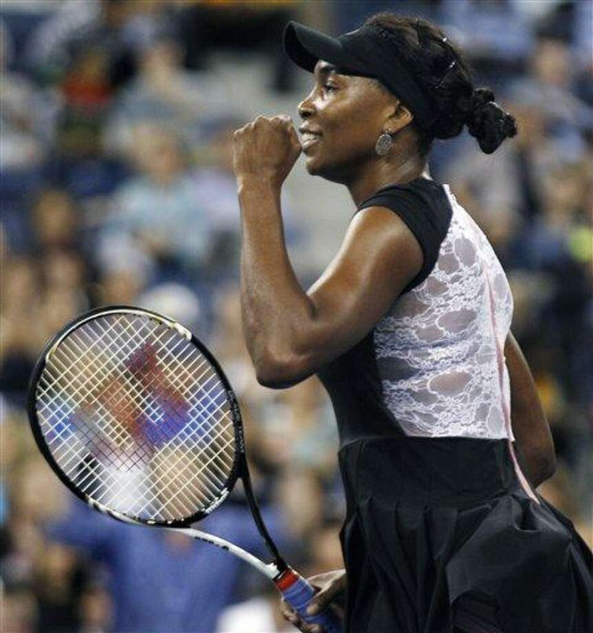 Venus Williams, of the United States, pumps her first after defeating Vesna Dolonts, of Russia, 6-4, 6-3 during the first round of the U.S. Open tennis tournament in New York, Monday, Aug. 29, 2011. (AP Photo/Charles Krupa) Photo: ASSOCIATED PRESS / AP2011