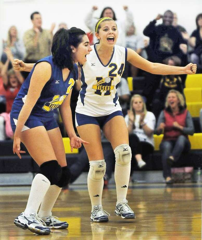 This Monday, Oct. 25, file photo, shows Mercy's Amber Bepko (24) and Nina Zimmitti celebrating during a match against Shelton. Mercy won 3-1 at home in Middletown, 25-19. Mercy finished the regular season 17-1. (Catherine Avalone / TheMiddletownPress