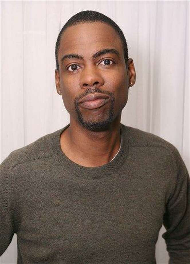 FILE - In this Sept. 14, 2009 file photo originally released by InStyle, Chris Rock is seen at the InStyle Lounge at the Toronto International Film Festival in Toronto. (AP Photo/Casey Rodgers, InStyle) Photo: AP / AP2010
