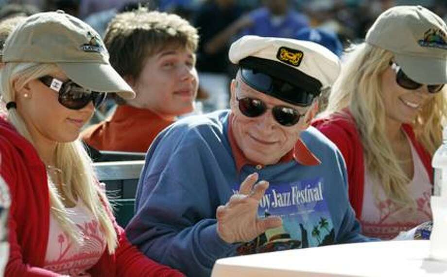 Hugh Hefner waves from his front row center box at the 32nd annual Playboy Jazz Festival at the Hollywood Bowl in Los Angeles Saturday, June 12, 2010. (AP Photo/Reed Saxon) Photo: AP / AP