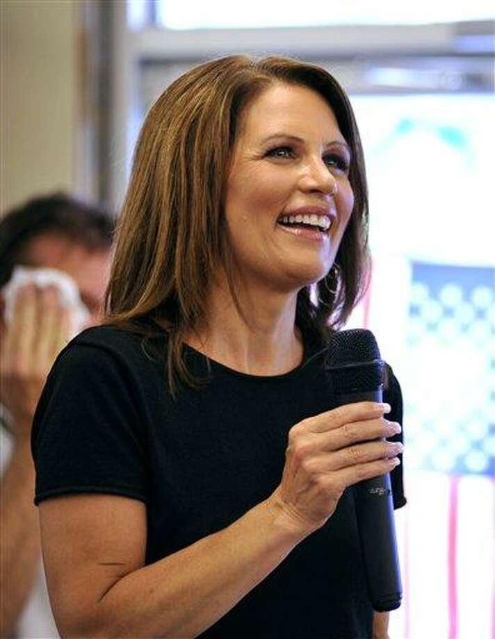 In this Aug. 26, 2011 file photo, Presidential candidate U.S. Rep. Michele Bachmann, R-Minn., speaks to supporters  during a campaign stop at Angie's Subs, in Jacksonville Beach, Fla. Sentinel, a conservative imprint of Penguin Group (USA), announced Monday, Aug. 29, that the Bachmann's memoir will arrive in November and already has been completed. The book, reports of which first circulated in June, is currently untitled. (AP Photo/Rick Wilson, file) Photo: AP / FR170516 AP
