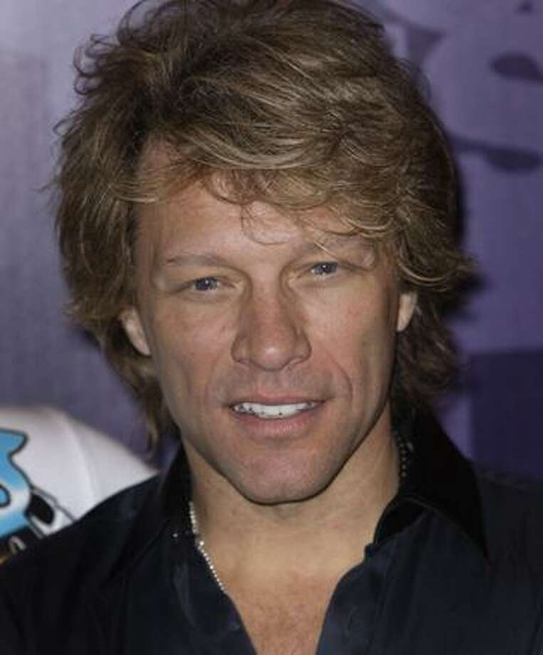 FILE - In this  June 7, 2010 file photo, Jon Bon Jovi smiles at a photocall ahead of his band's 12 show residency at London's o2 arena in east London.  Bon Jovi was able to finish a concert in his home state of New Jersey Friday night, July 10, 2010 despite tearing a calf muscle toward the end of the show. (AP Photo/Joel Ryan, file) Photo: ASSOCIATED PRESS / AP