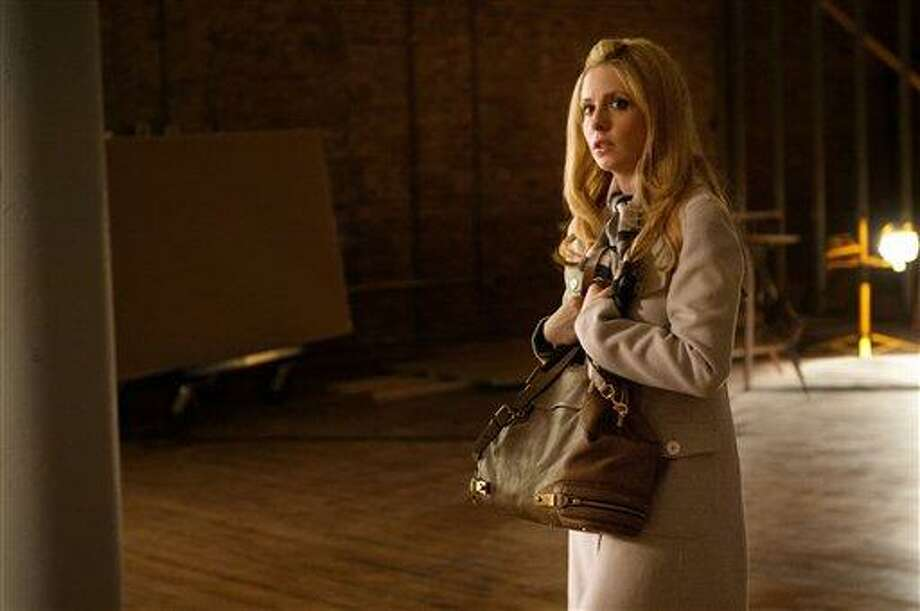 "In this image released by the CW, Sarah Michelle Geller is shown in a scene from ""Ringer,"" premiering Sept. 13, 2011 on the CW. (AP Photo/CW, Jojo Whilden) Photo: AP / ©2011 The CW Network, LLC. All Rights Reserved."