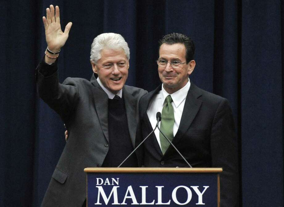 Former President Bill Clinton, left, campaigns for Democratic candidate for governor Dan Malloy, right, at a rally at the University of Hartford in West Hartford. Malloy faces Republican Tom Foley in the Nov. 2 election. (AP Photo/Jessica Hill) Photo: AP / AP2010