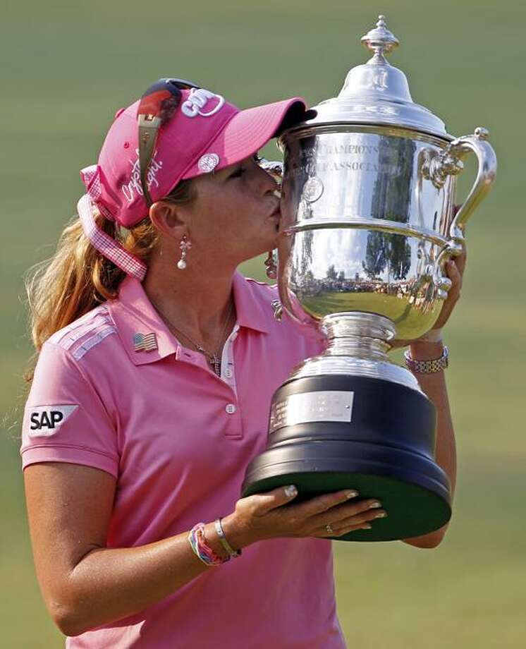 Paula Creamer kisses the trophy after winning the U.S. Women's Open golf tournament at Oakmont Country Club in Oakmont, Pa., Sunday. Creamer has won her first major after a final-round, 2-under 69 gave her a 3-under 281 for the tournament. (AP Photo/Gene J. Puskar) Photo: AP / AP