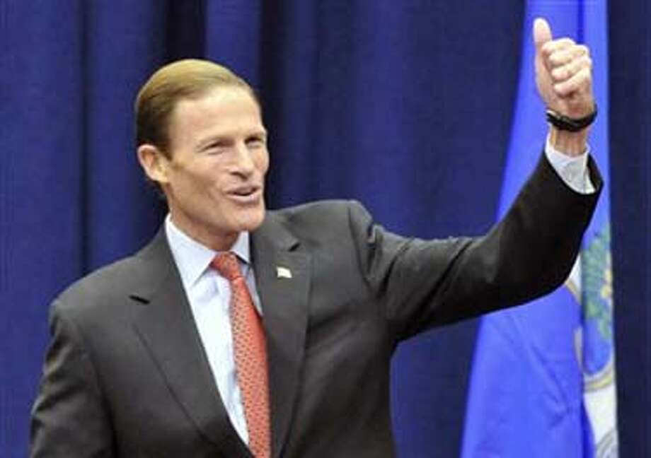 Democratic candidate for U.S. Senate Richard Blumenthal gives the thumbs up to an audience during a rally at the University of Hartford in West Hartford, Conn., Saturday, Oct. 31, 2010. The Connecticut Attorney General Blumenthal is battling former World Wrestling Entertainment CEO Linda McMahon for the senate seat being vacated by the retiring Sen. Chris Dodd.  (AP Photo/Jessica Hill) Photo: AP / AP2010