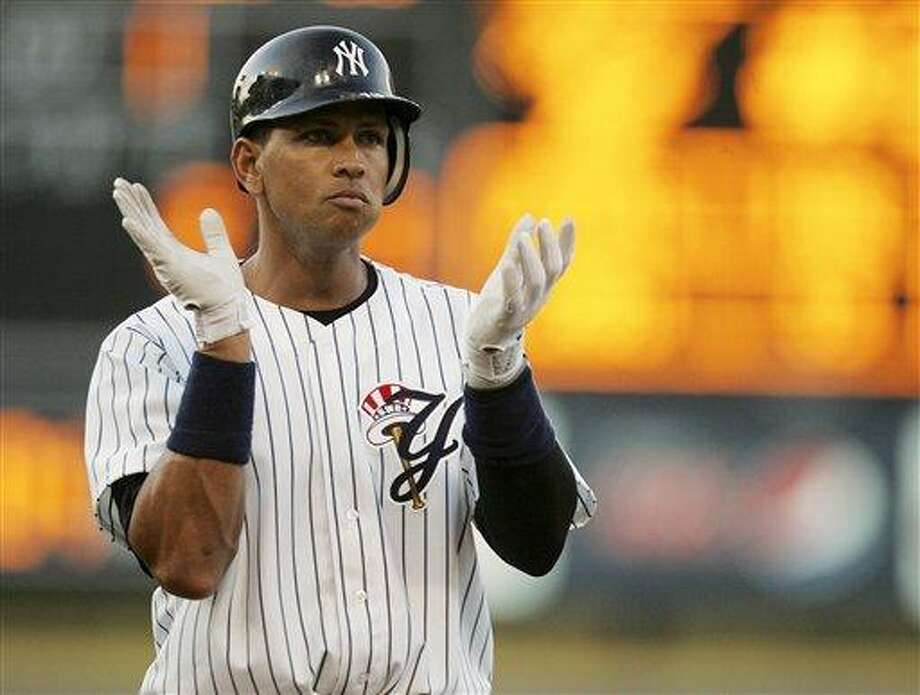 New York Yankees third baseman Alex Rodriguez  claps along with the fans after drawing a walk in the first inning in a minor league rehab start for Triple-A affiliate, Scranton/ Wilkes-Berry Yankees against the Durham Bulls at PNC Field in Moosic Pa., Wednesday, Aug. 17, 2011. Rodriguez is set to rejoin the Yankees Thursday in Minnesota in his return from knee surgery. (AP Photo/Rich Schultz) Photo: ASSOCIATED PRESS / AP2011