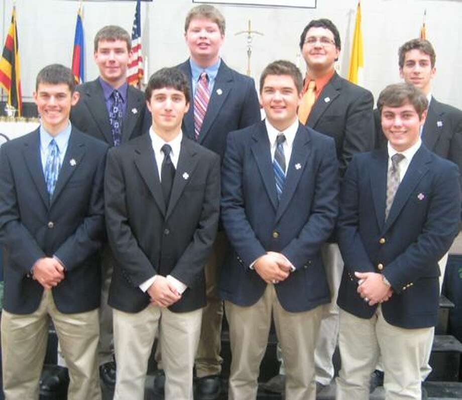 Eight Xavier Seniors wearing the pins they were just presented as new Extraordinary Ministers of the Eucharist.  Front Row: (l-r) Jake Randazzo, Daniel Quartararo, Colin  D'Amelio,  Michael Breault; 2nd Row: (l-r) Zachary Newton, Luke McCarthy, Alex Kobak, and  Mark Scalzo.