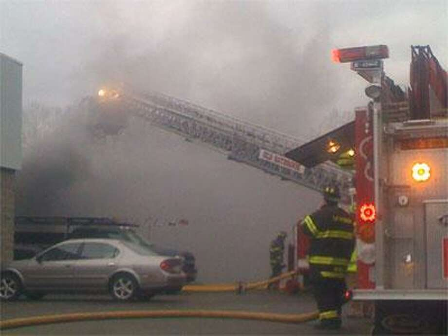 Old Saybrook firefighters respond to a blaze at the Grossman Nissan dealership on Saturday. (Photo by C.J. Dunn)