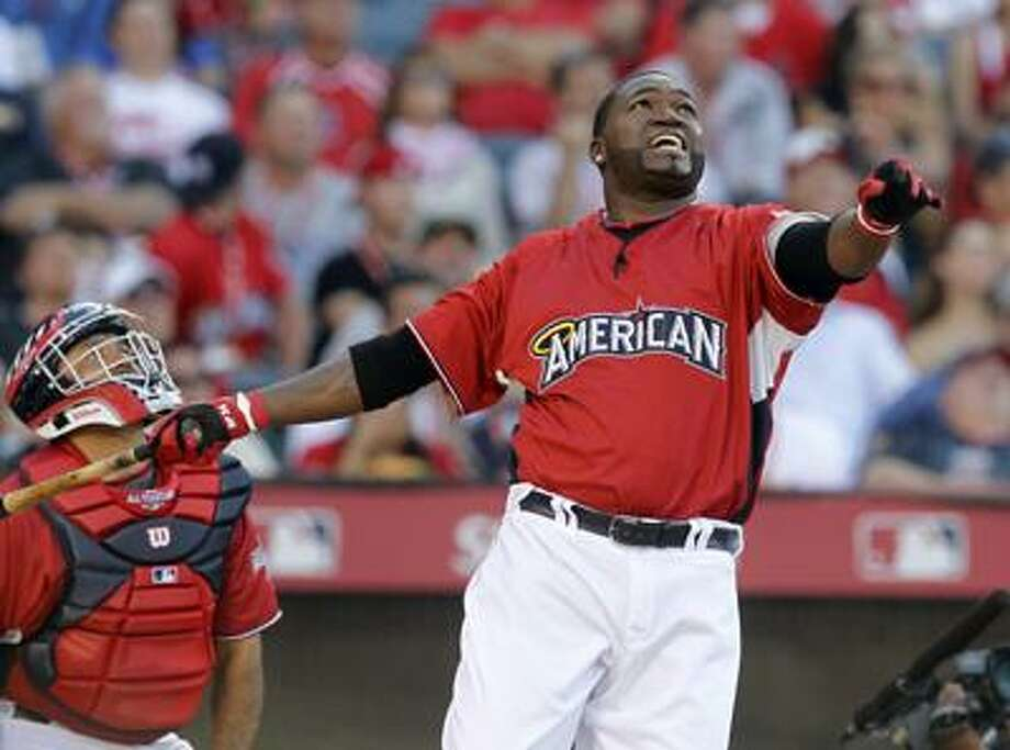 Boston Red Sox's David Ortiz watches the flight of a home run during the first round of baseball's All-Star home run derby Monday, July 12, 2010, in Anaheim, Calif. (AP) Photo: AP / AP
