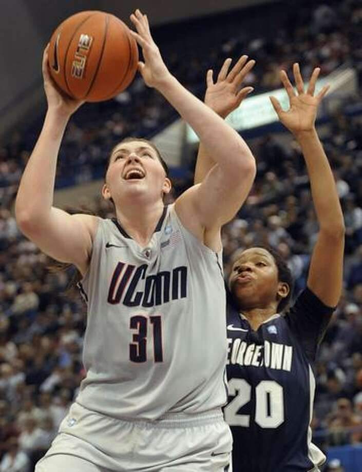 Connecticut's Stefanie Dolson (31) is guarded by Georgetown's Monica McNutt during the second half of a quarterfinal NCAA college basketball game at the Big East Conference Championships in Hartford, Conn., Sunday, March 6, 2011. (AP Photo/Jessica Hill) Photo: ASSOCIATED PRESS / AP2011