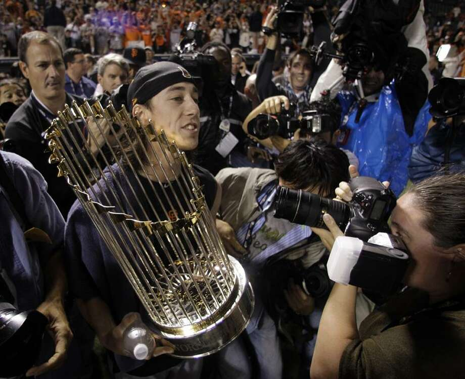 San Francisco Giants' Tim Lincecum celebrates after Game 5 of baseball's World Series against the Texas Rangers Monday in Arlington, Texas. The Giants won 3-1 to capture the World Series. (AP Photo/Tony Gutierrez) Photo: AP / AP