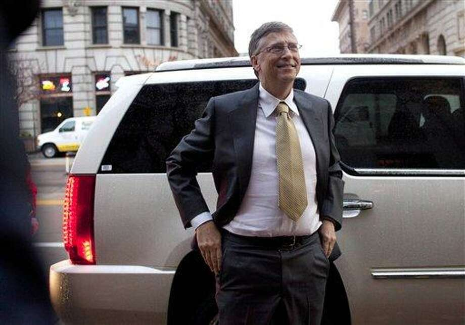 In this Nov. 21, 2011 photo, Bill Gates arrives  to testify in a $1 billion antitrust lawsuit at the Frank E. Moss federal courthouse in Salt Lake City.  Associated Press Photo: AP / AP2011