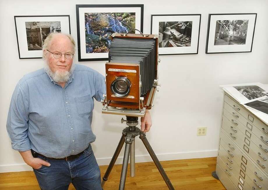 "East Hampton resident Ralph Phil, a member of the New England Large Format Photography Collective, is seen with his camera. The NELFPC is a group of photographers dedicated to preserving traditional methods of producing a photographic image. The NELFPC are the sponsors of the third annual ""Raid Our Gallery"" benefit and champagne reception, which will take place Thursday, April 8, at the Middlesex Hospital Cancer Center, 536 Saybrook Road, Middletown. Phil donated three of the 150 original, signed, large format photographic prints. To view this year's ""Raid Our Gallery"" images and for more information about NELFPC, visit <a href=""http://www.nelfpc.com"">www.nelfpc.com</a>. For more information on the event, contact Sally Ann Lee at (860) 358-6200.(Catherine Avalone"